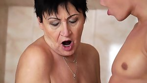 Horny granny enjoys steamy oral stint with a younger guy