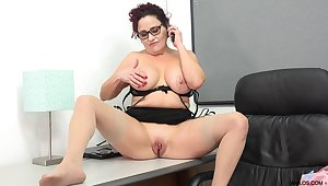 Mature with big tits amazes with solo office porn